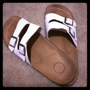 White buckled sandals